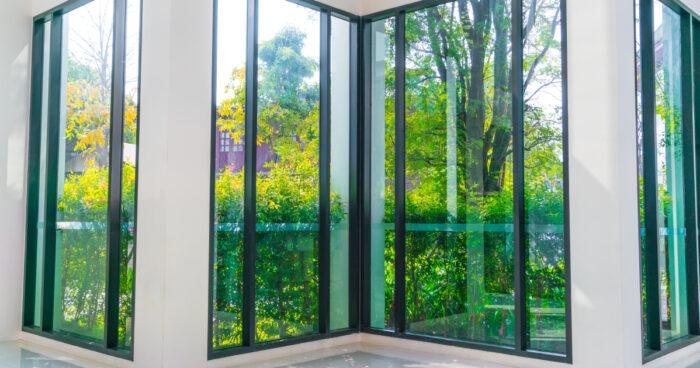 glass window overlooking green garden 1